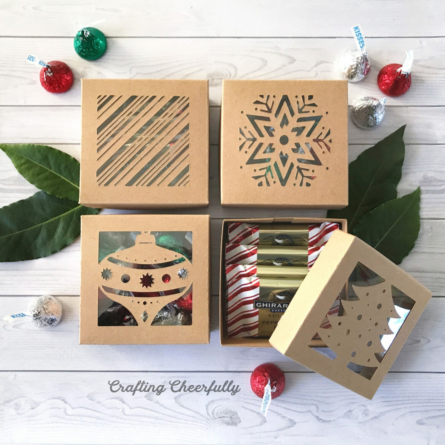Holiday boxes made from chipboard featuring cut out designs.