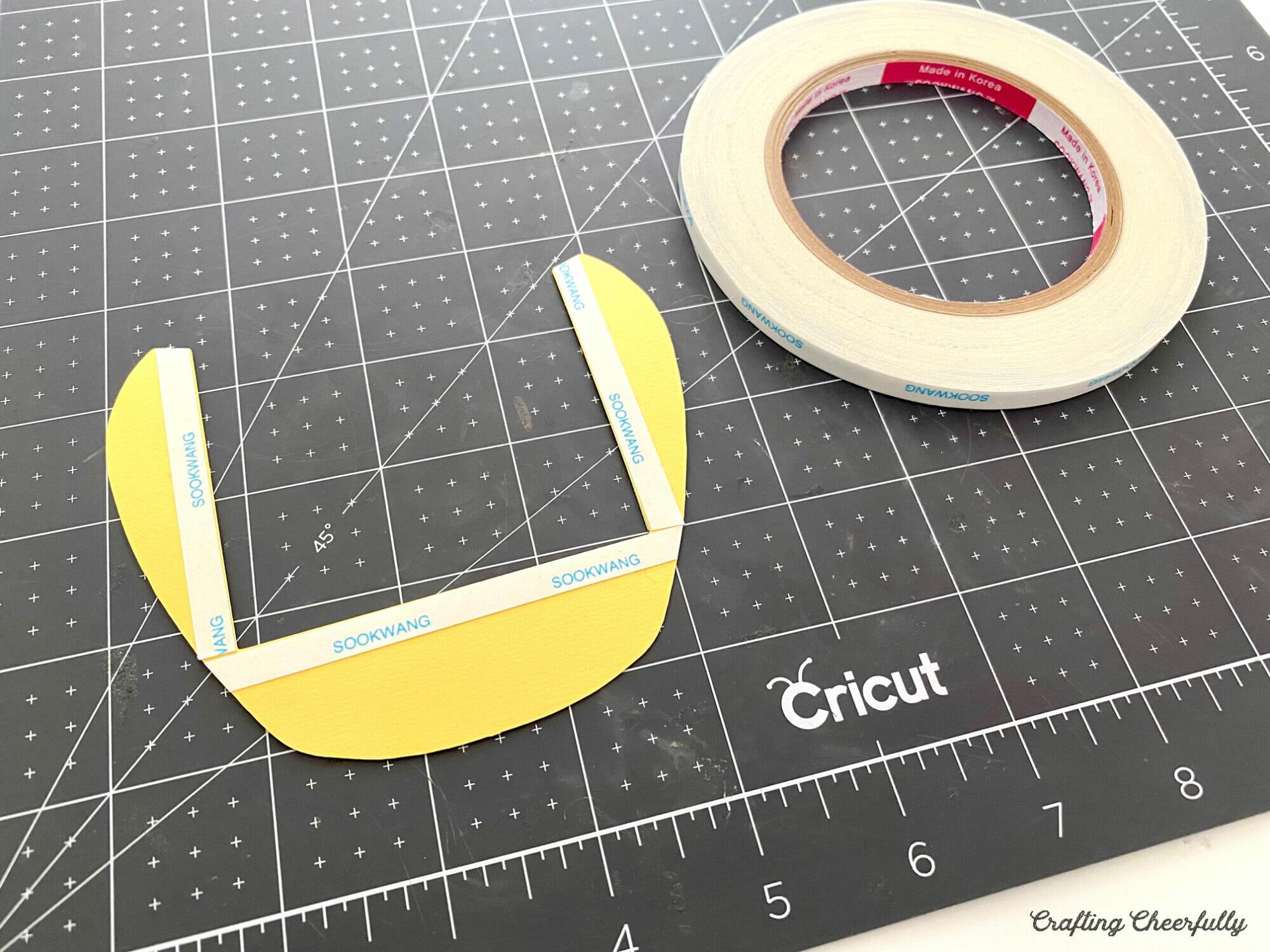 honey pot slider card pieces being assembled on a black cutting mat.