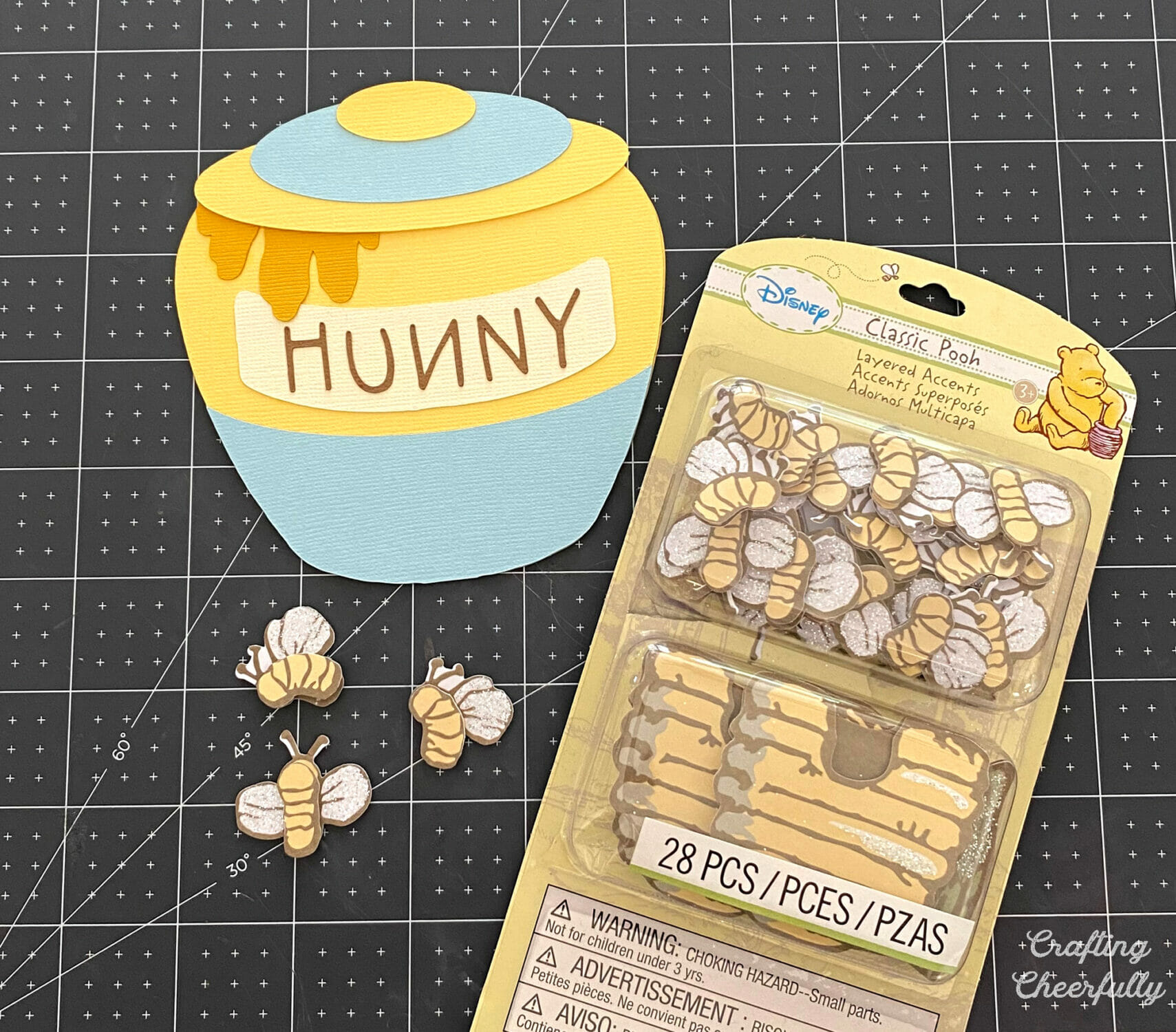 Bumblebee embellishments are added to the honey pot card.