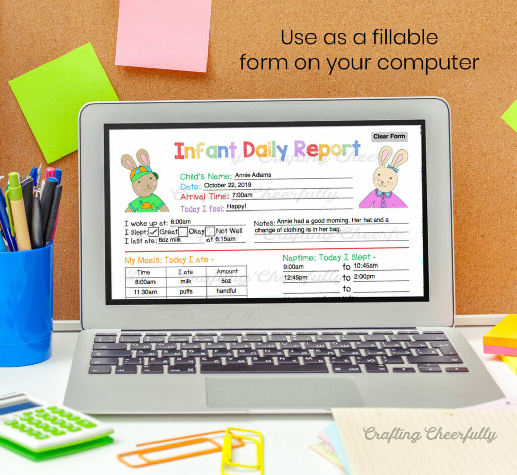 Laptop with the infant daily report on the screen in front of a bulletin board with colorful post-it notes.