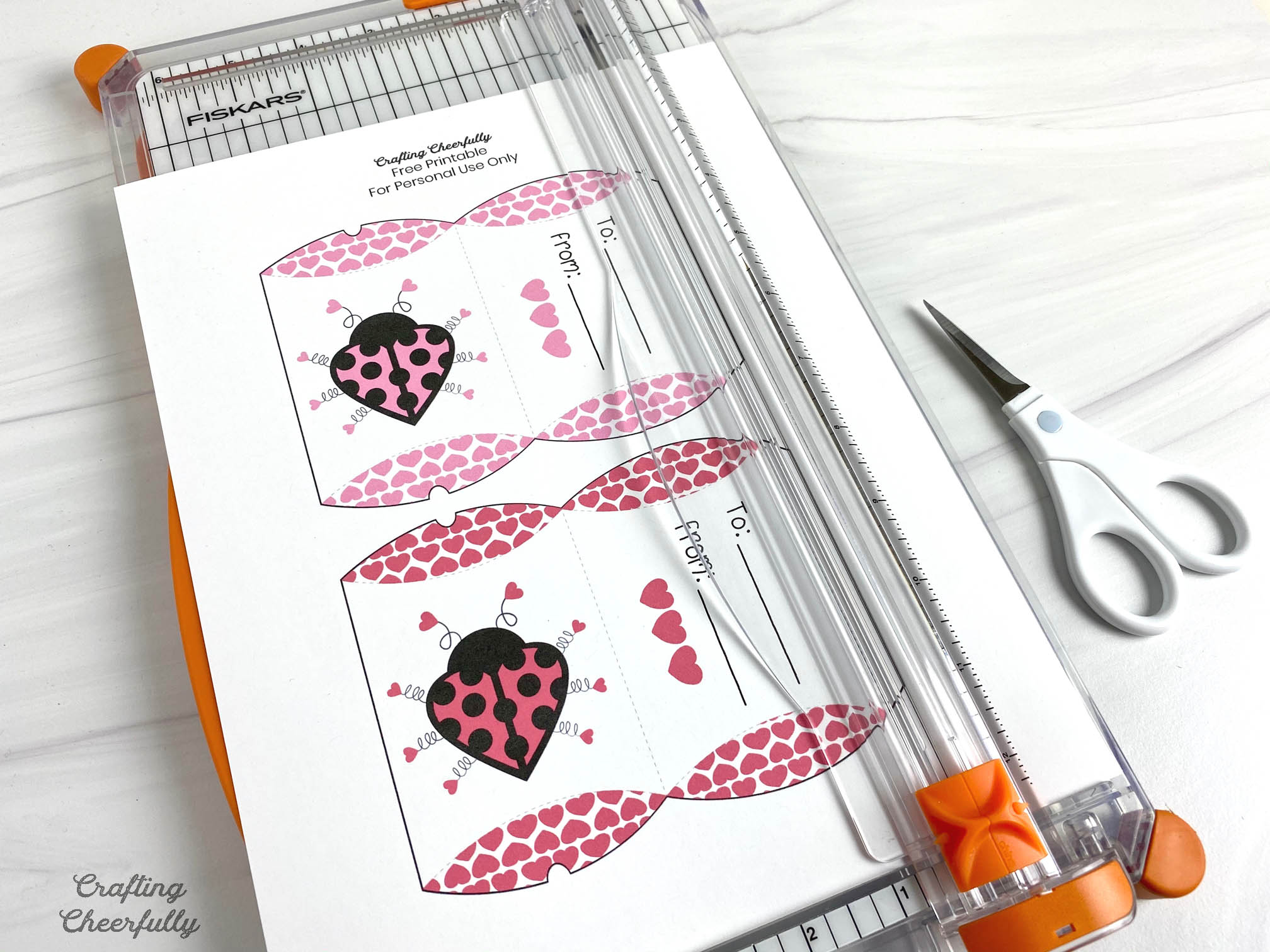 Free printable love bug pillow boxes trimmed with paper trimmer.