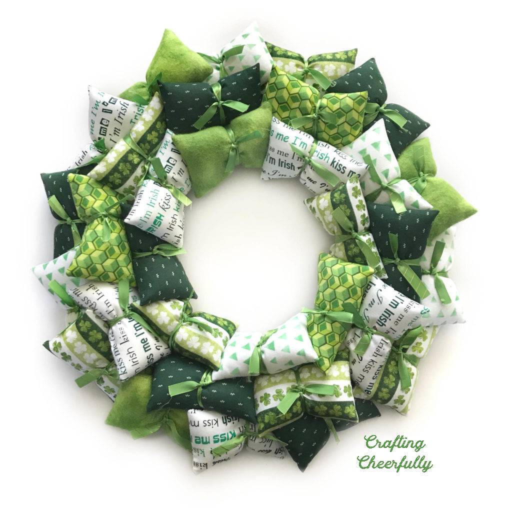 Pillow wreath made with green and white fabrics.