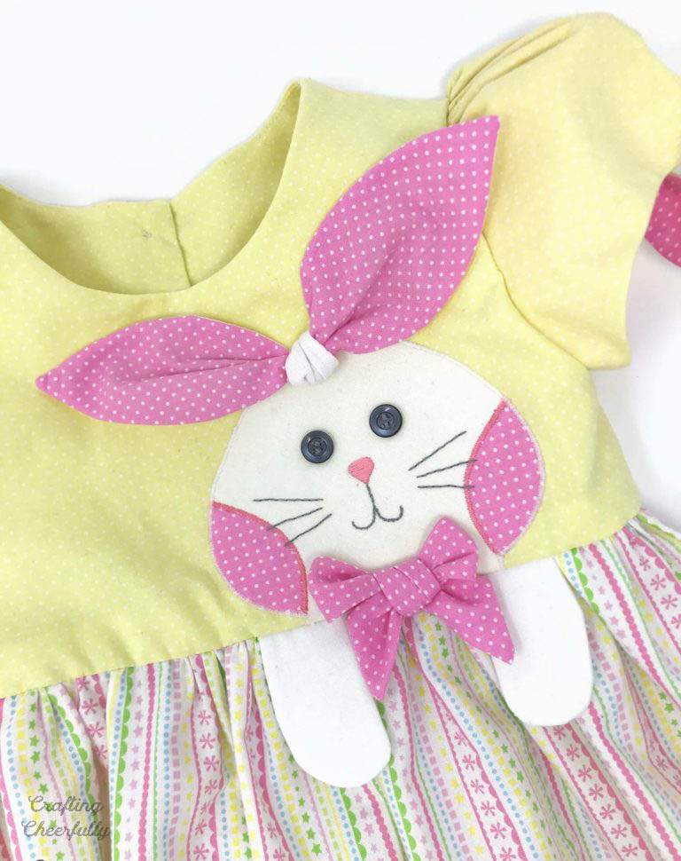 Bunny dress for Easter. Pastel colored dress with bunny on the front.