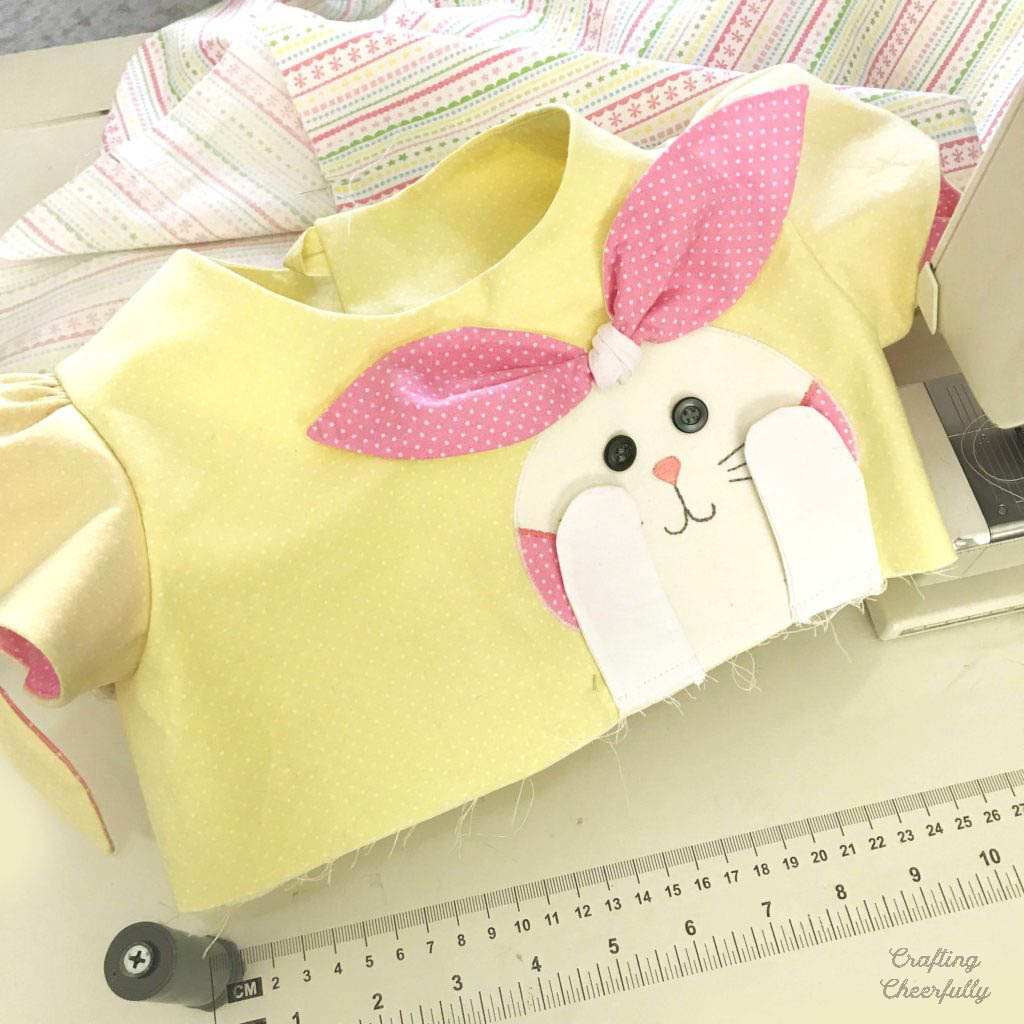 Handmade Bunny Dress with Cute Bunny Applique added to bodice in white and pink fabric.