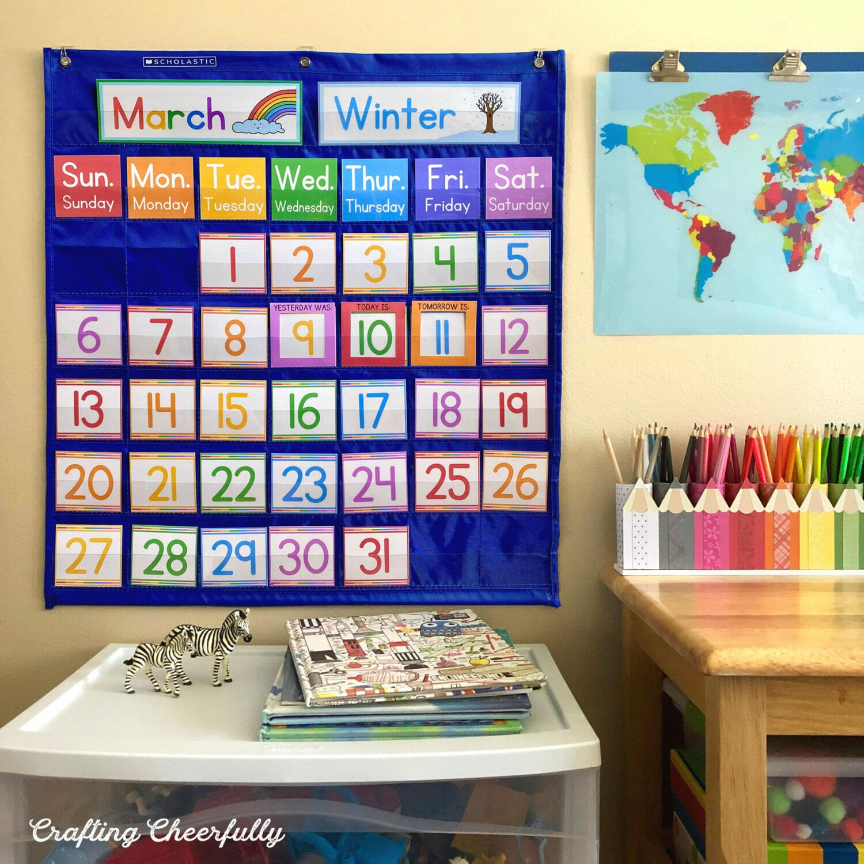 Pocket chart children's calendar hanging up in a home classroom.