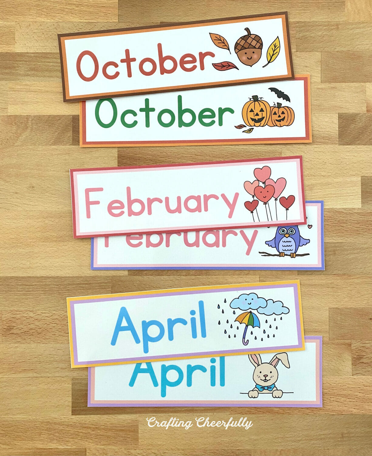Pocket chart printables showing the month cards on a table.