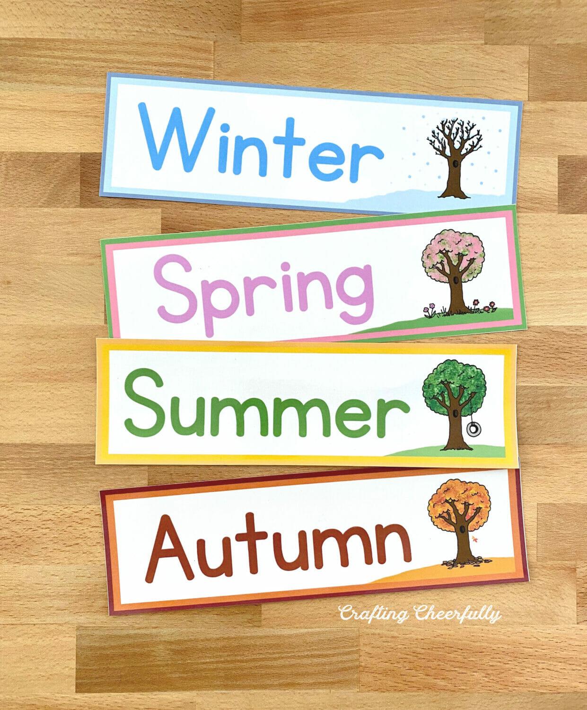 Season cards for pocket chart calendar featuring trees from each season.