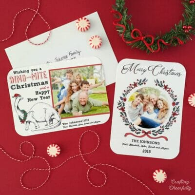 Holiday cards on a red tabletop.