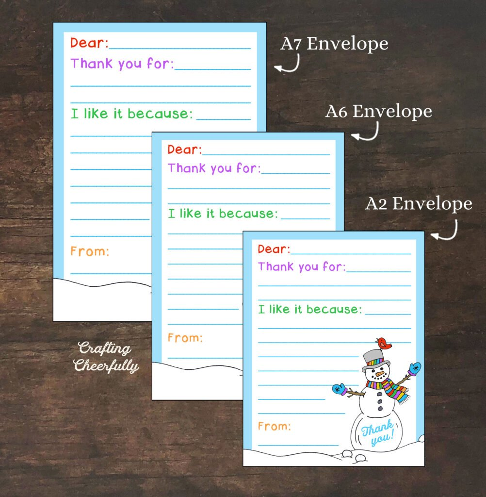 Snowman printable thank you card in three different sizes laying on a wooden table. Text with sizes A7, A6 and A2 envelopes point to each card.