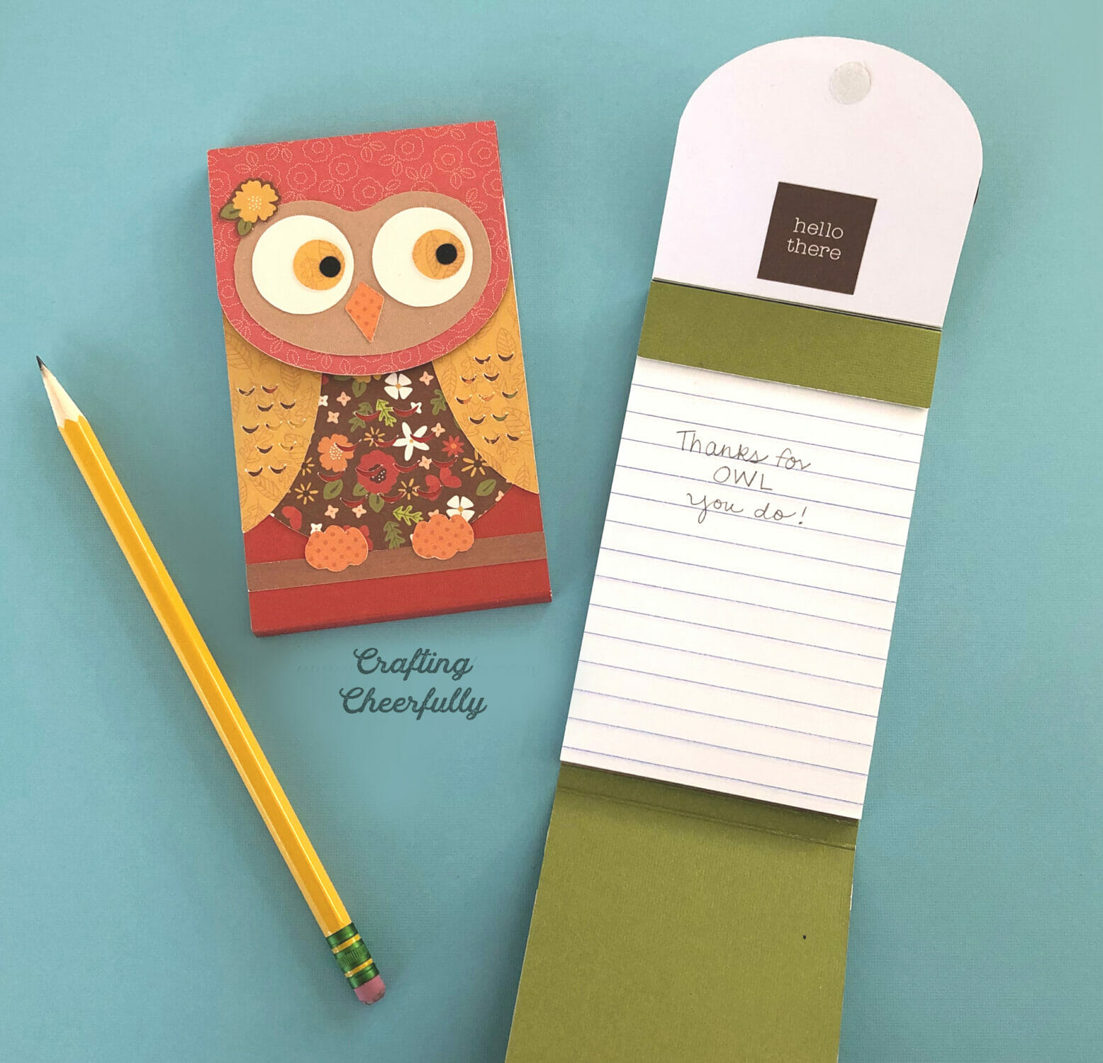 """Owl notepads on a blue table top. One notepad is open with """"Thanks for OWL you do!"""" written down."""