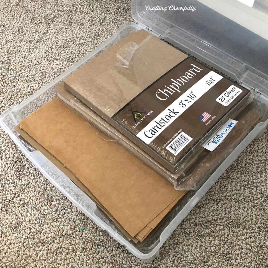 Chipboard stored in a plastic case lays open to show the chipboard.