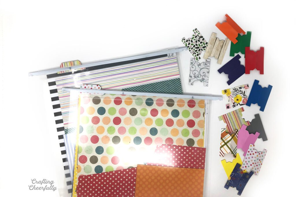 """12"""" x 12"""" scrapbook paper is organized in file folders by color and pattern."""