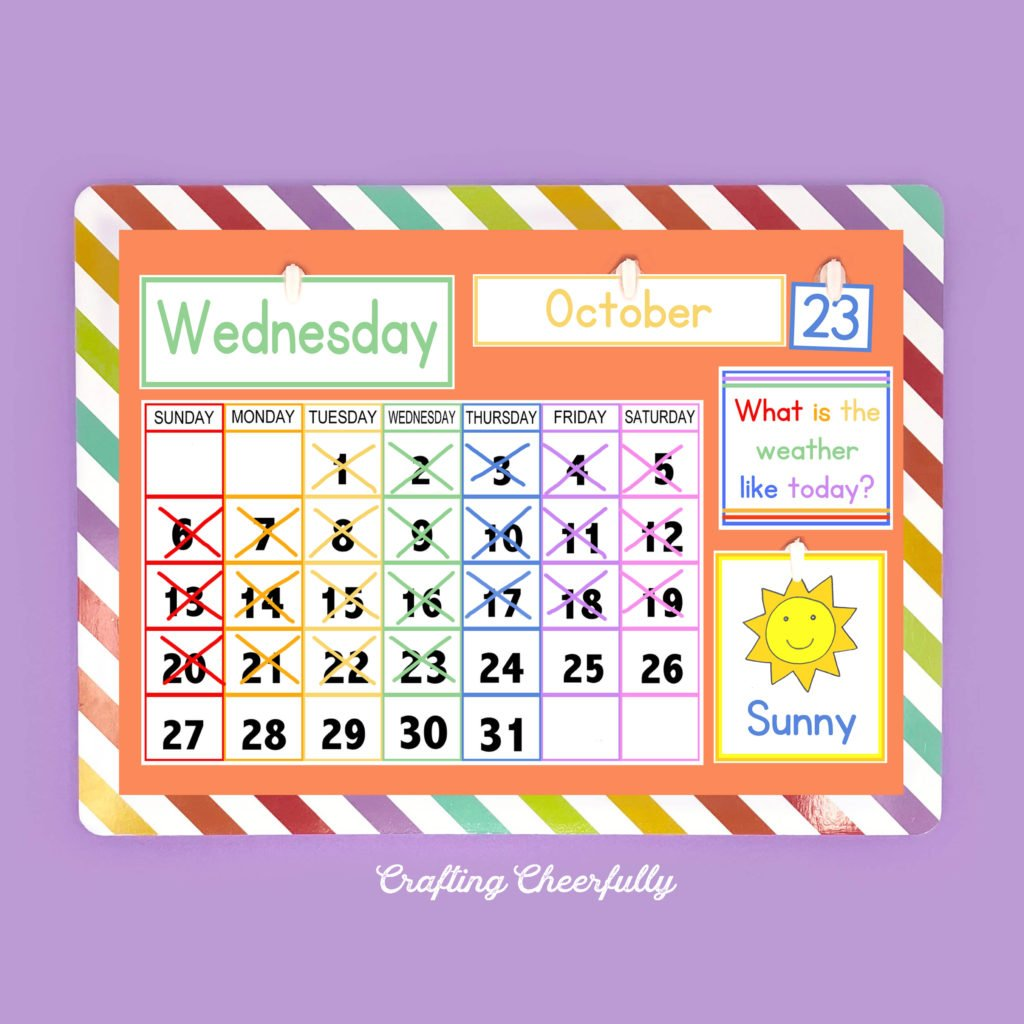 A colorful handmade children's calendar lays on a purple background.