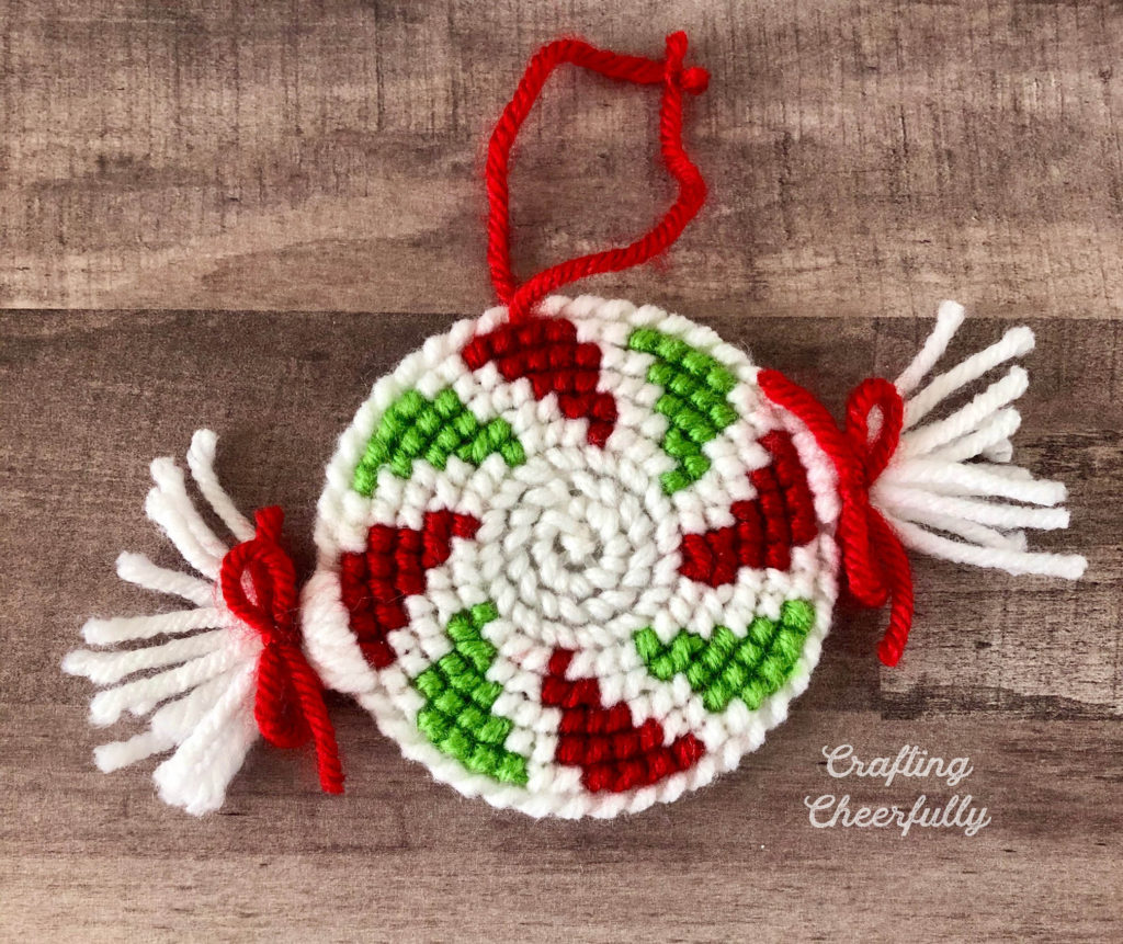 Peppermint ornaments made with yarn and plastic canvas.