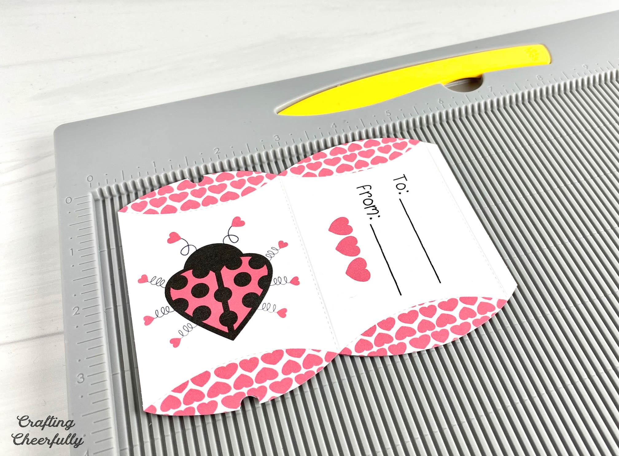 Love Bug Printable box on a scoring board.