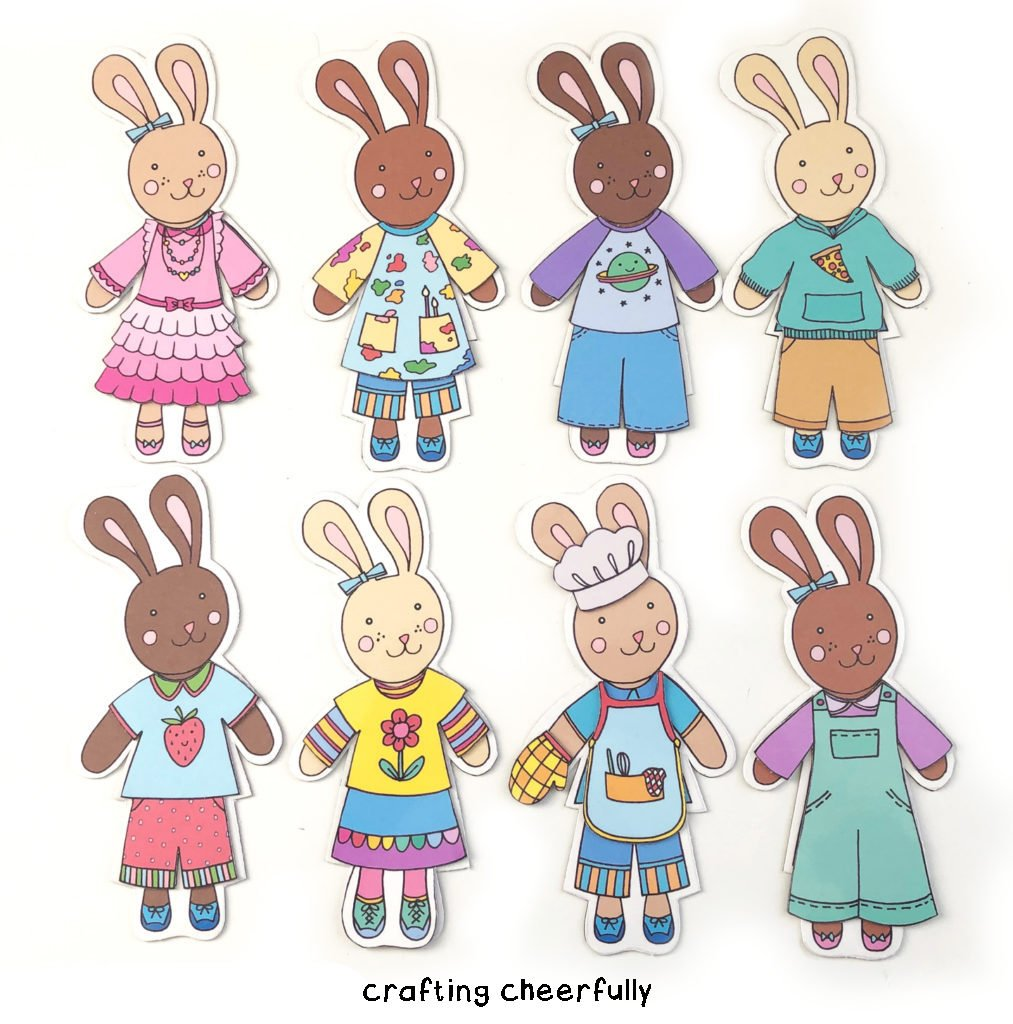 Bunnies of all different colors dressed in bright and colorful clothing lay on a white background.