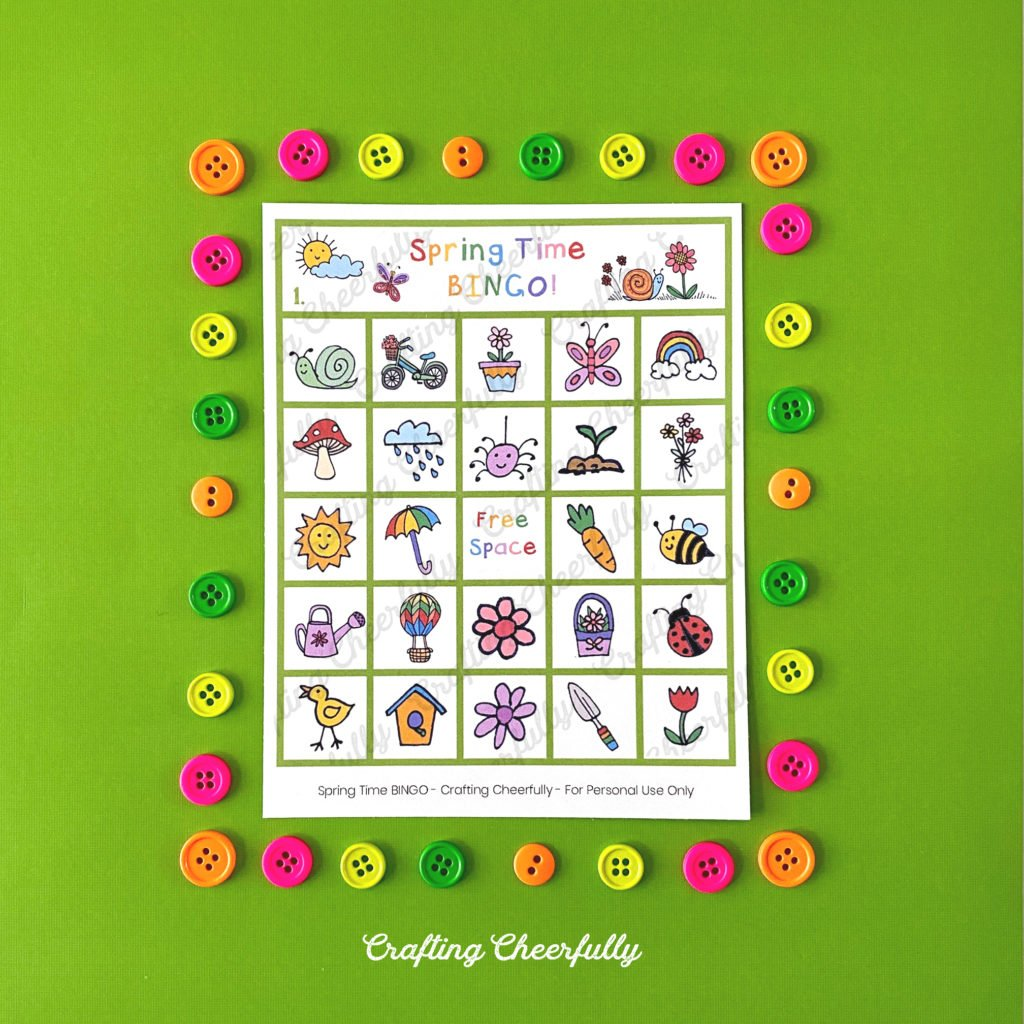 Spring Time BINGO Board with cute buttons around it on a green background.