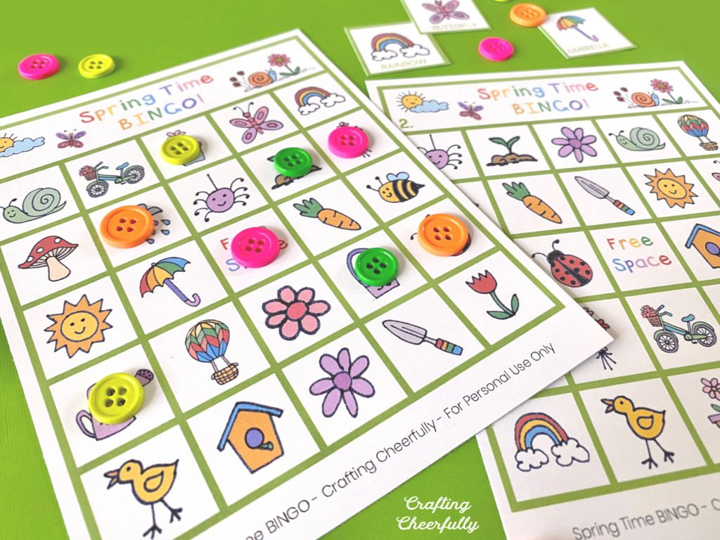 Spring Time BINGO Boards with buttons covering some of the spaces.