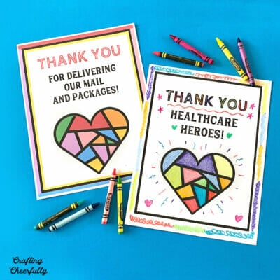 """Printable posters that say """"Thank you Healthcare Workers"""" and """"Thank you for delivering our mail and packages"""" on a blue background with crayons."""
