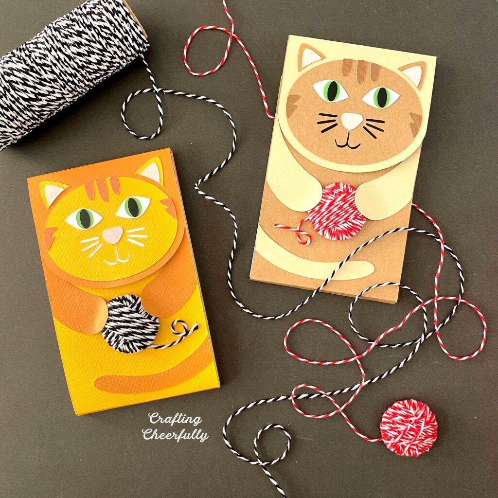 DIY Cat Notepads holding balls of yarn.