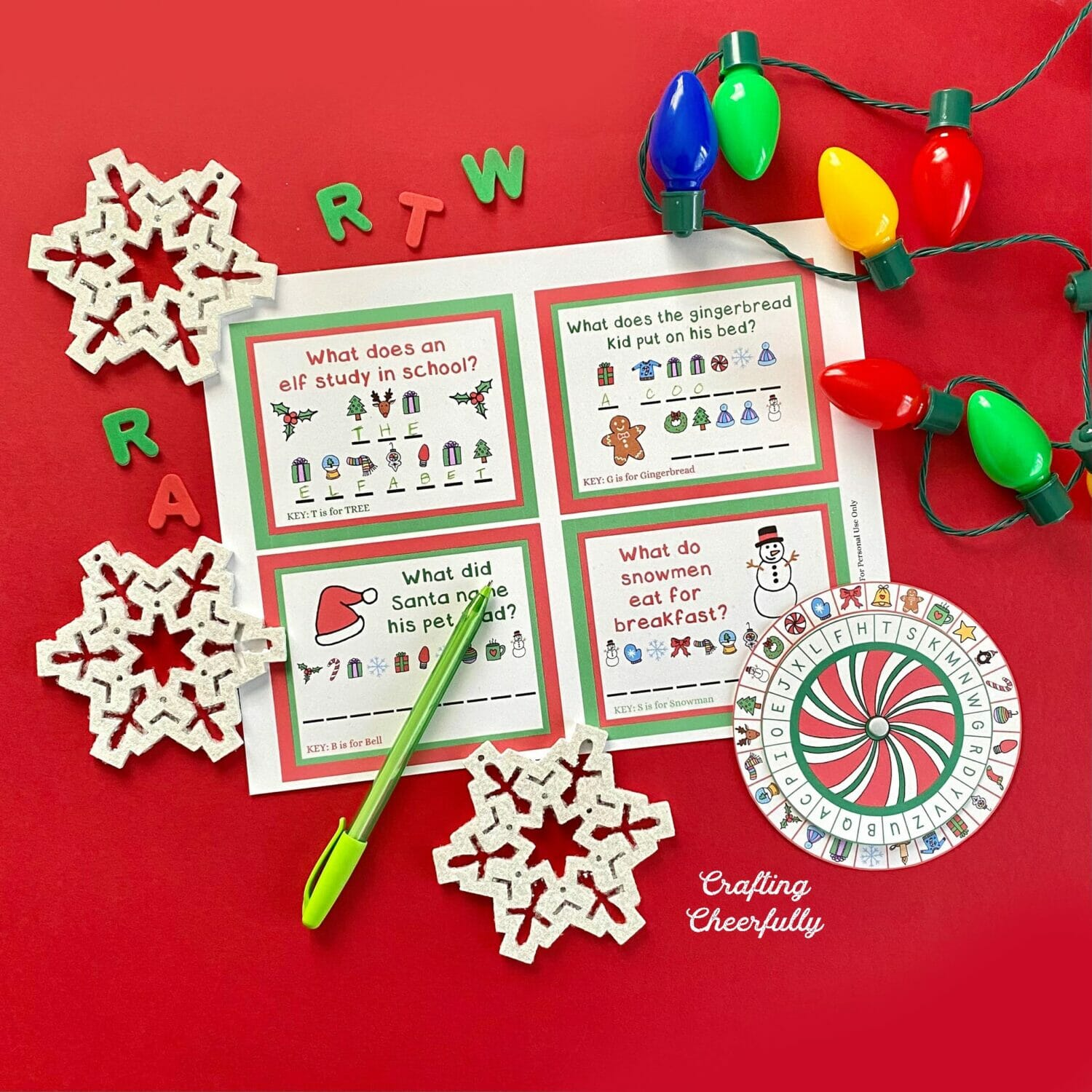 Christmas decoder wheel printables on a red background with snowflakes and holiday lights.