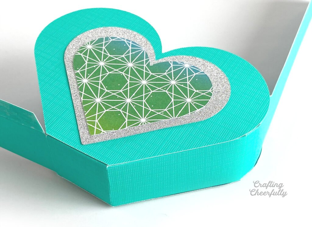 The teal heart box is beginning to take shape. One side is attached and the other still needs to be.