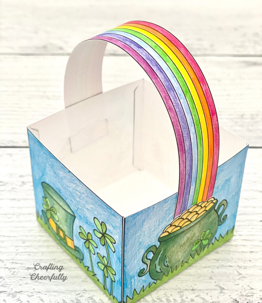 The rainbow handle is added to the St. Patrick's Day treat box.