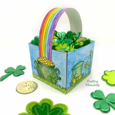 St. Patrick's Day Coloring Box sits on a table with gold coins and shamrocks.