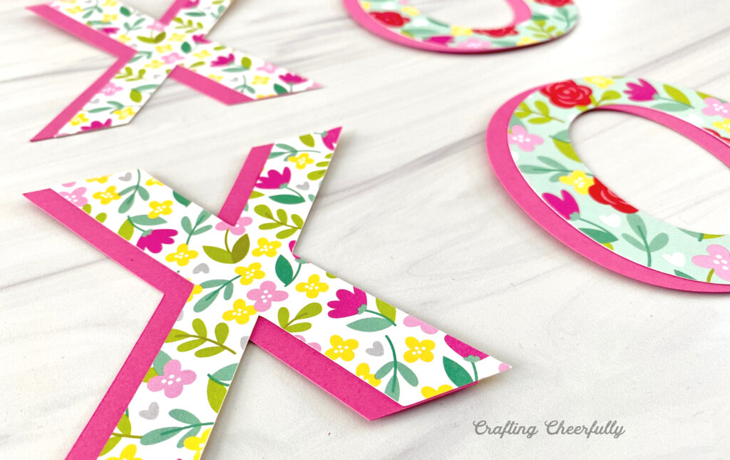X and O letters are laying on a table ready to make a Valentine's Day Banner!