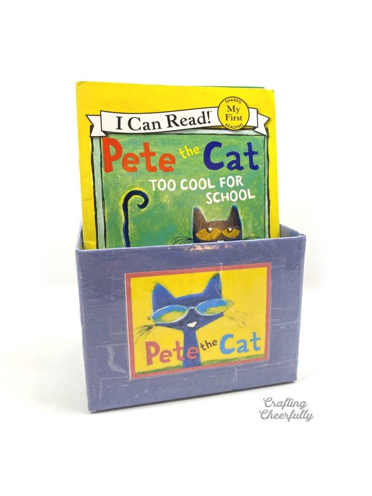 "Blue book bin filled with ""Pete the Cat"" books."