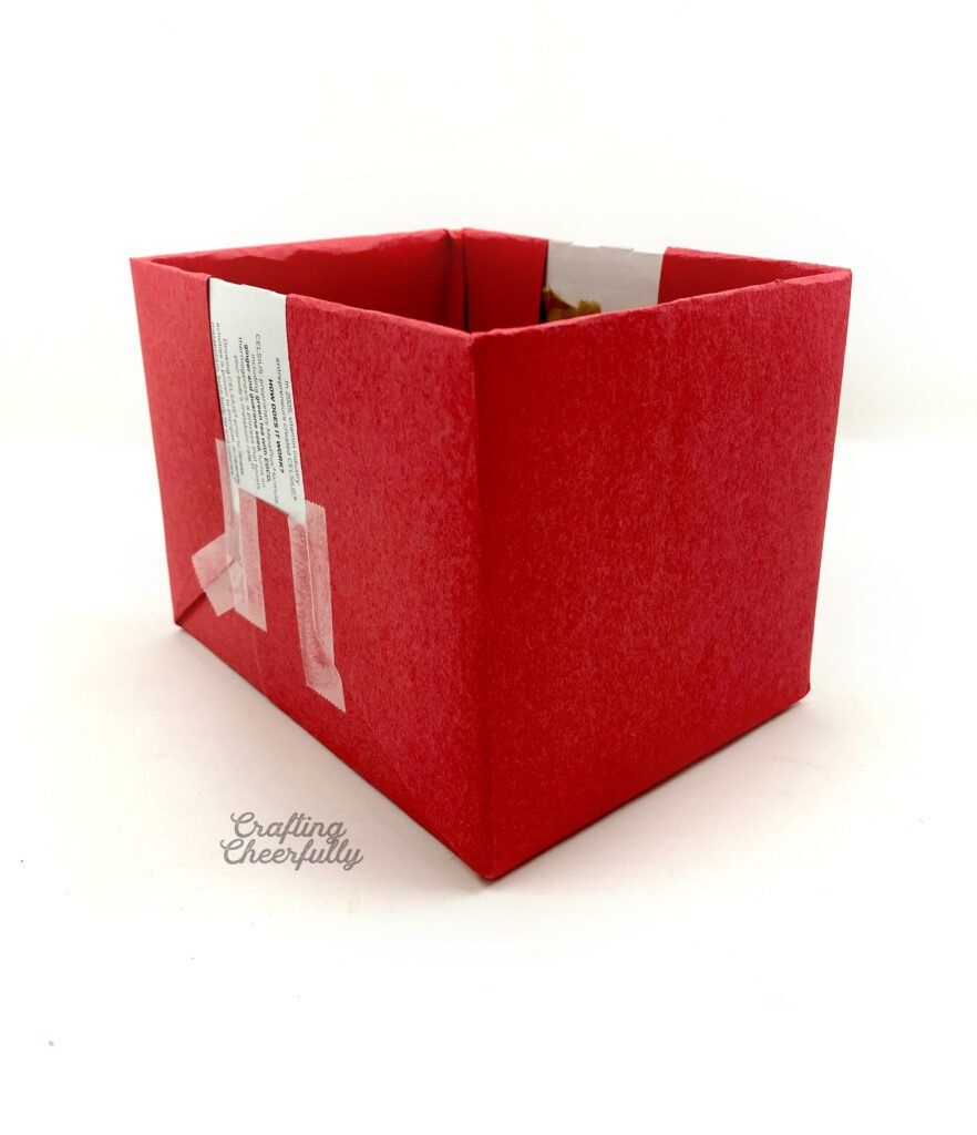 Red paper covers both ends of the cardboard box.