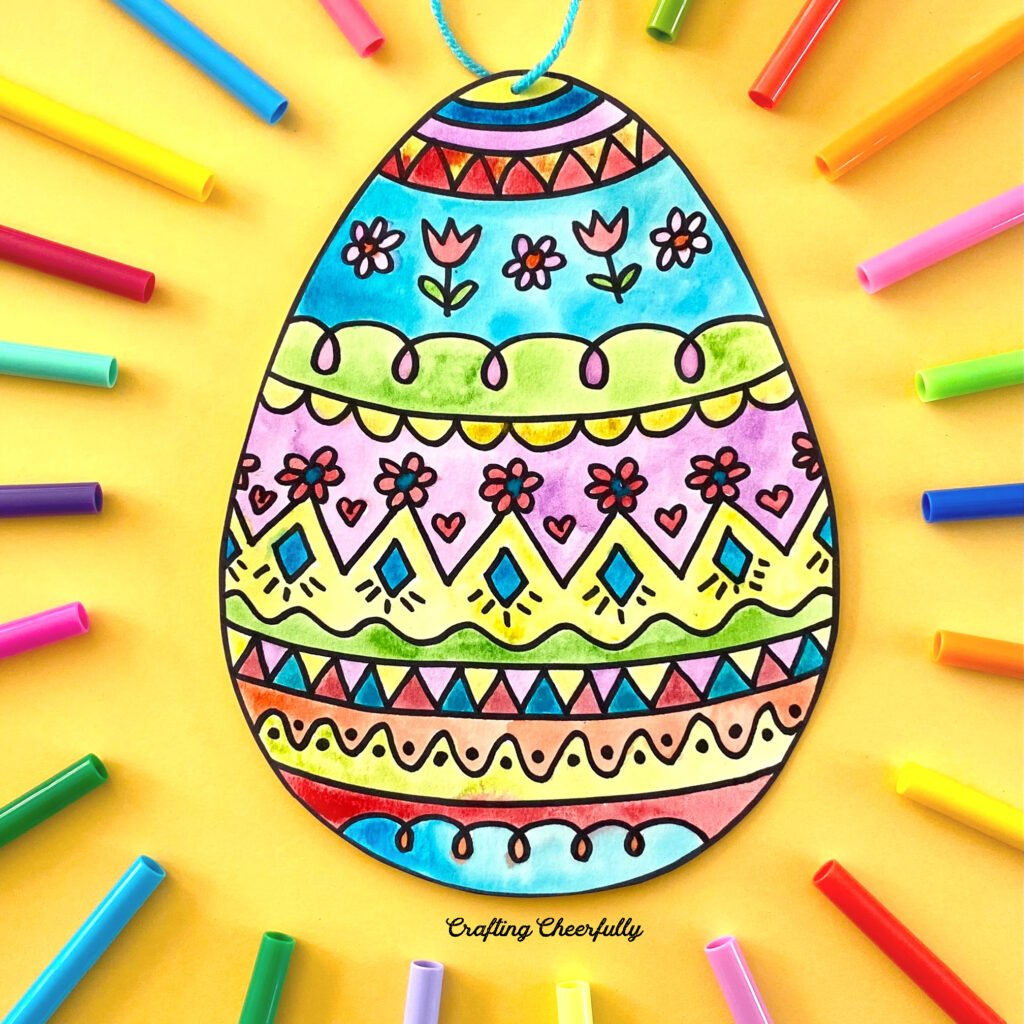 Colorful Easter egg with cute doodles on a yellow background with colorful markers surrounding it.