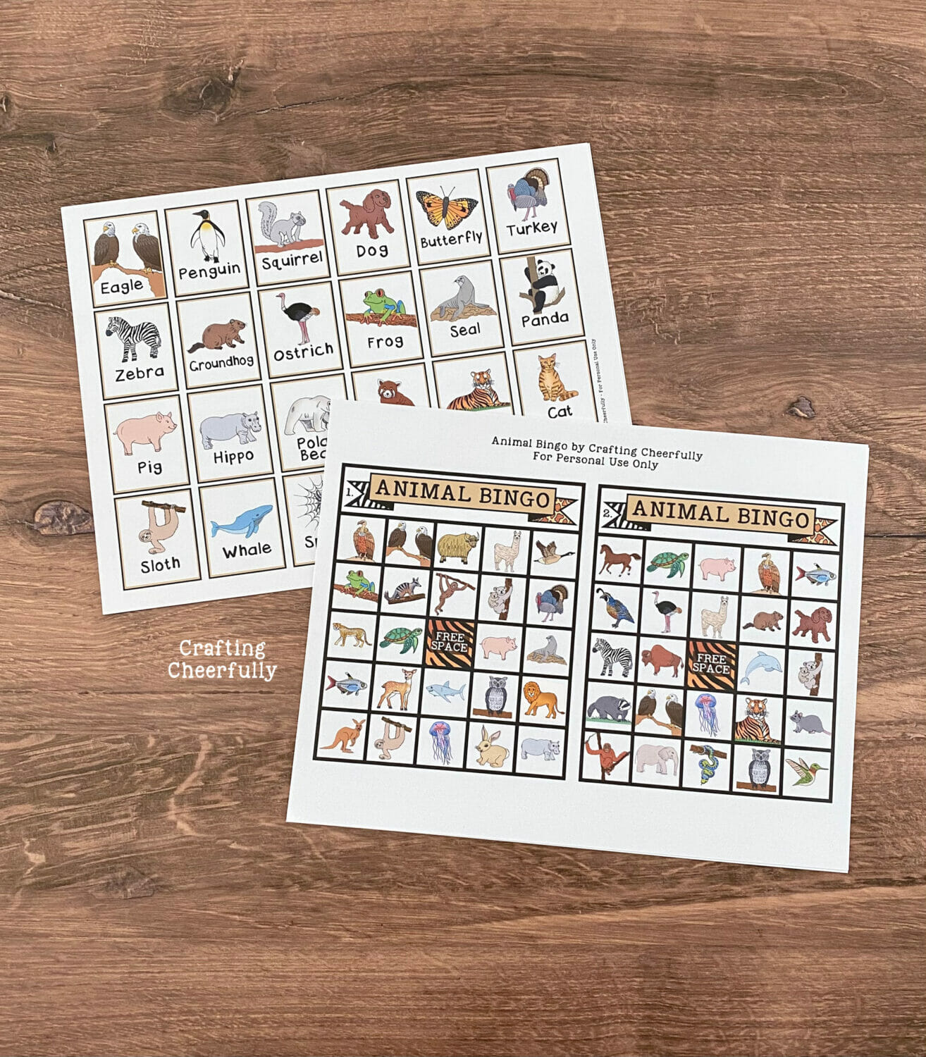 Animal Bingo boards and calling card printables on a table.