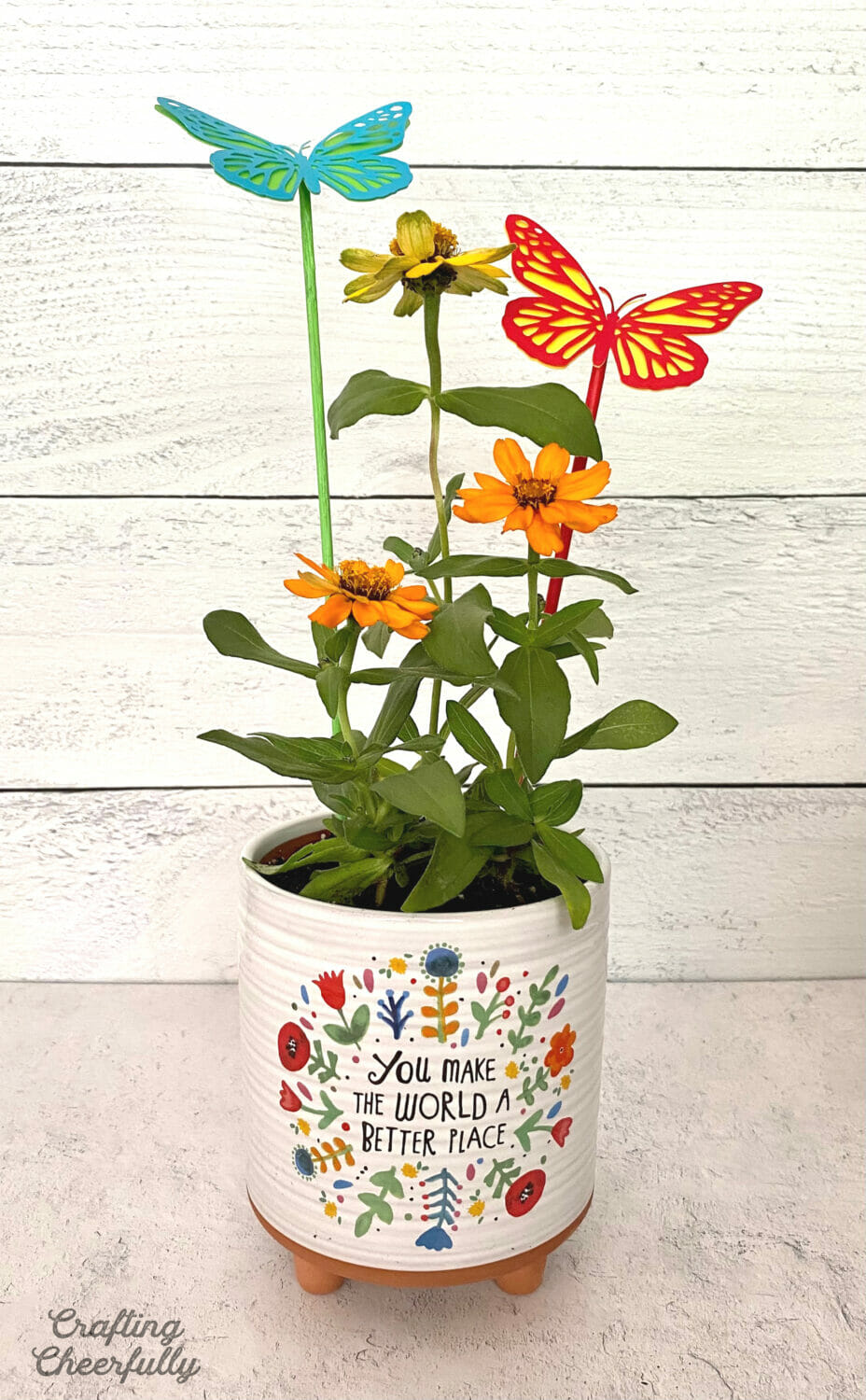 House plant gift pot with zinnias and handmade butterfly plant stakes.