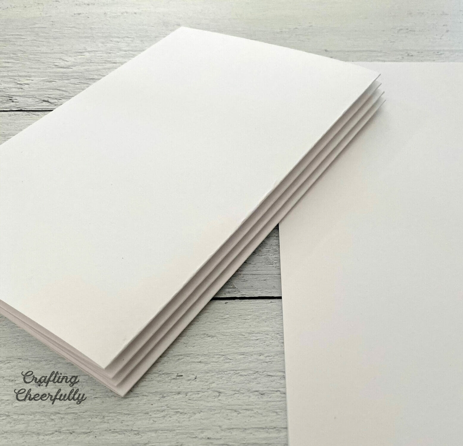 Stack of folded white paper.
