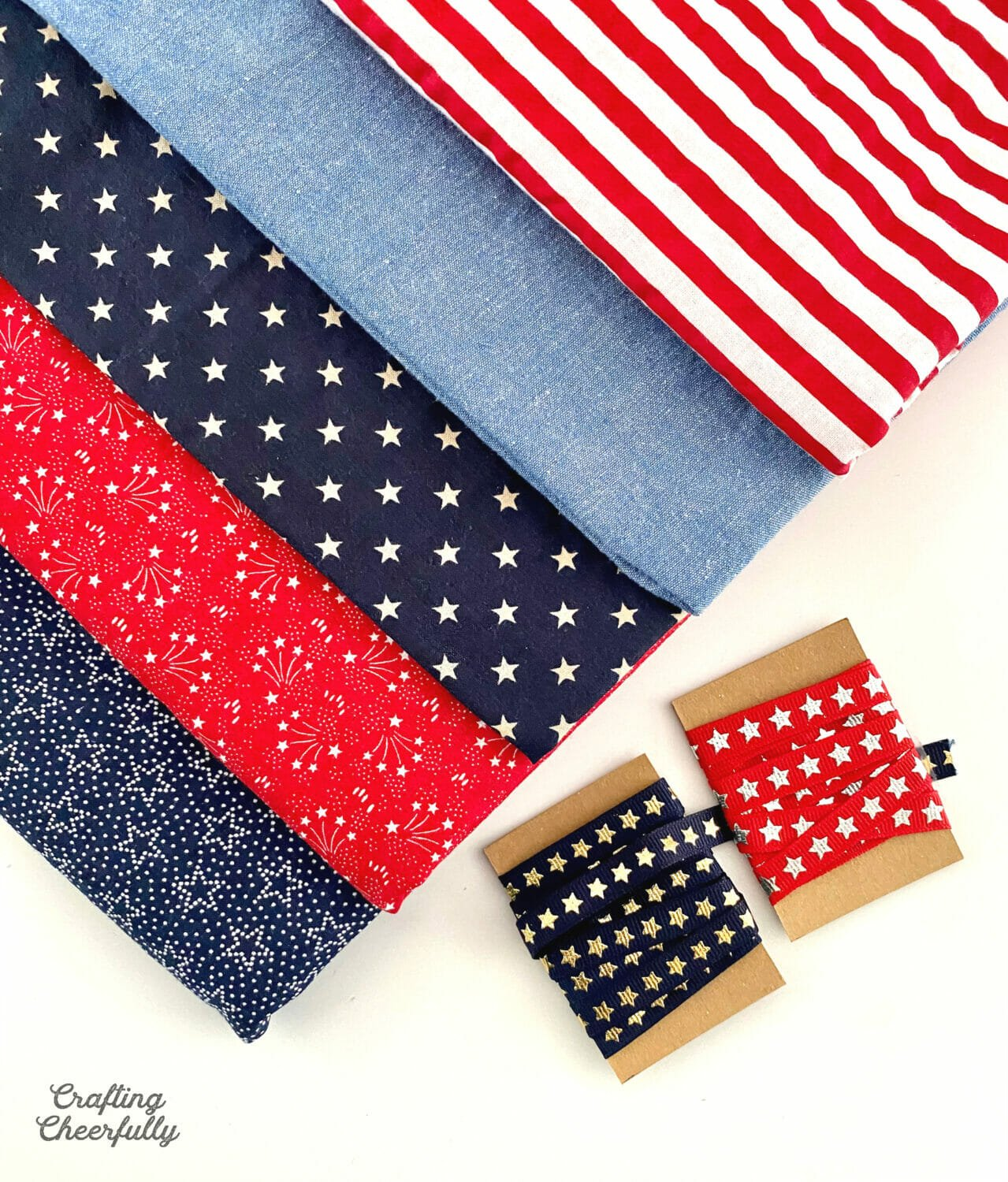 Red, white and blue fabric laying next to star ribbon.