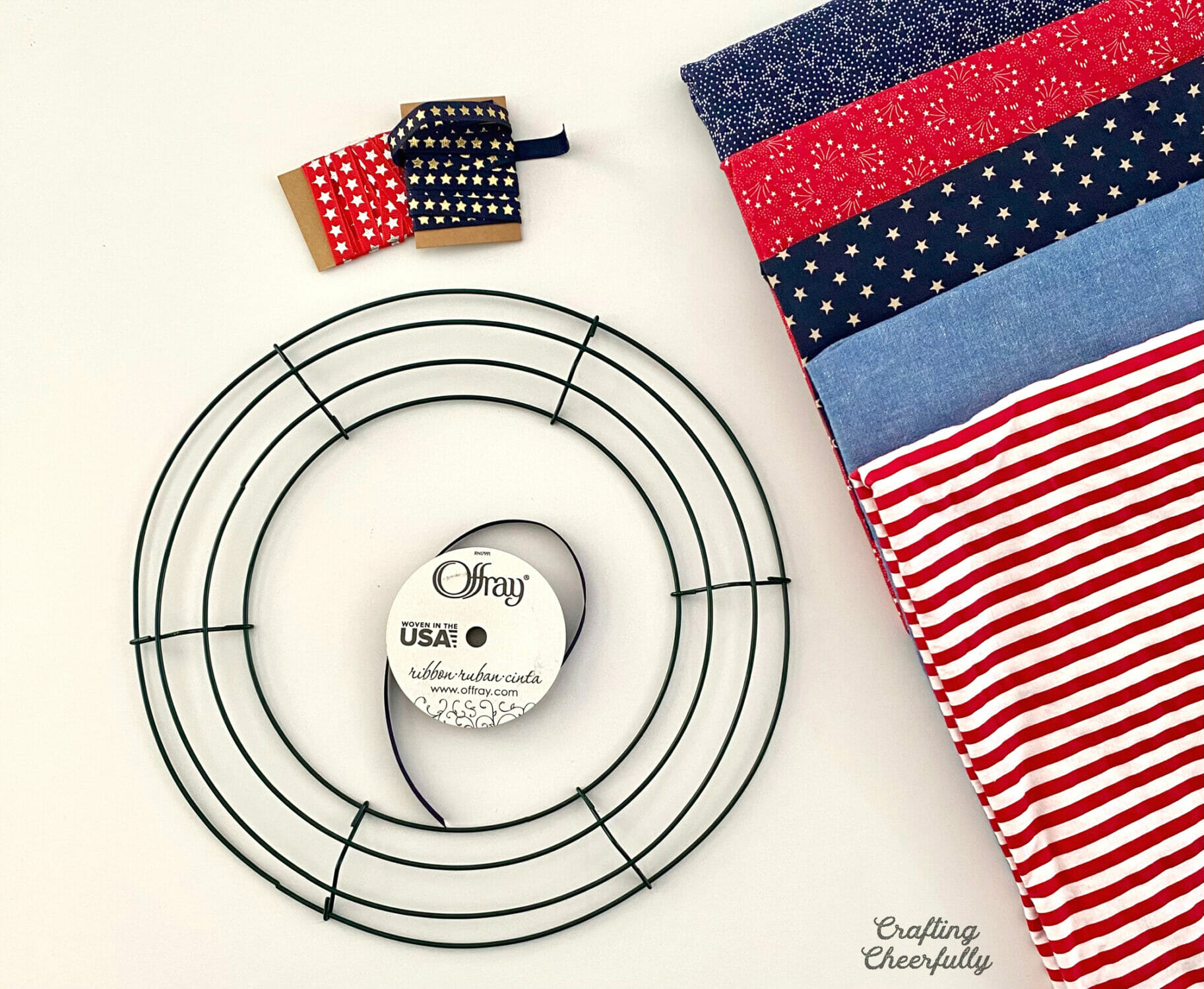 Supplies needed to make a patriotic pillow wreath.