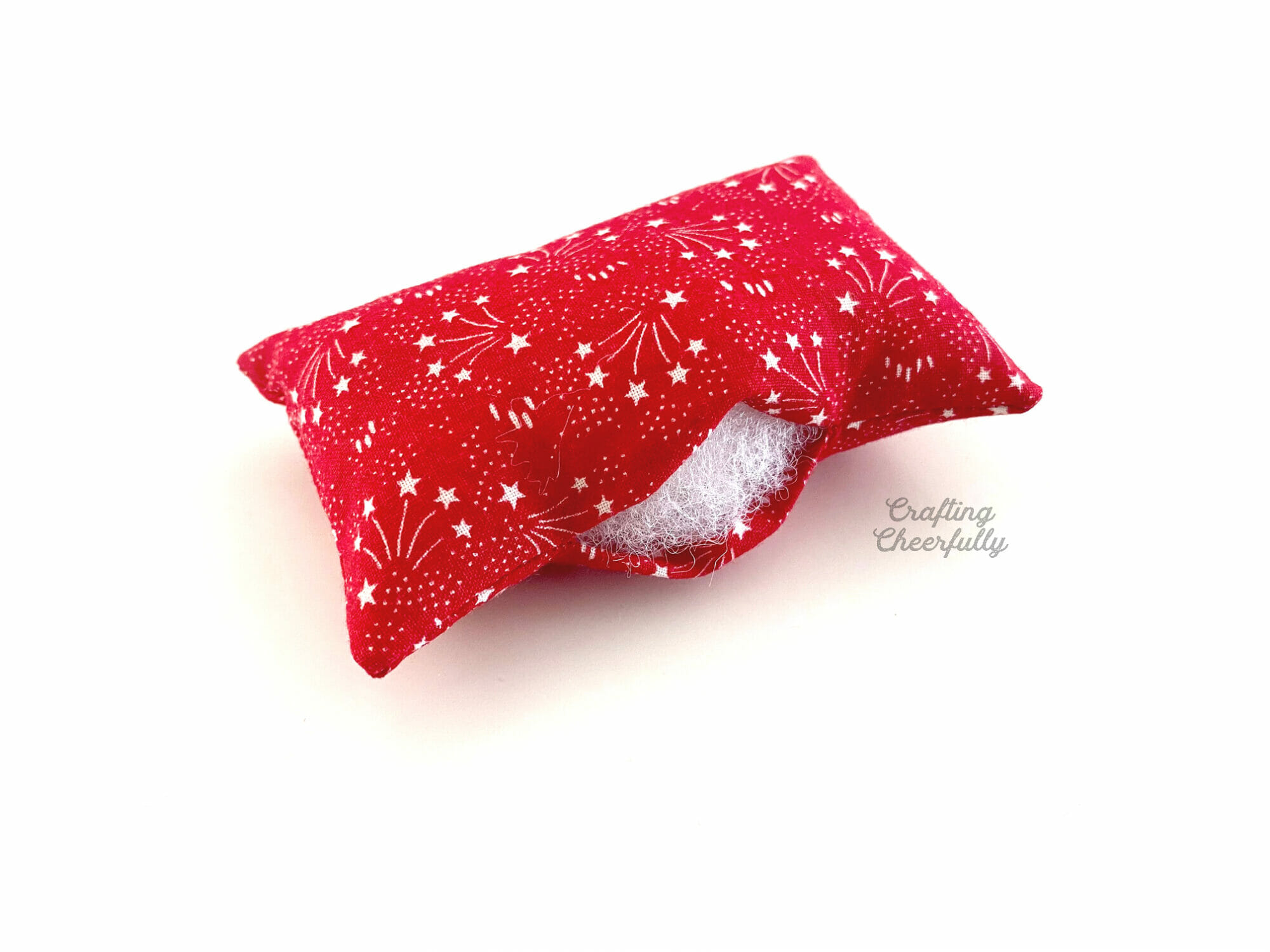 Red pillow stuffed with polyfil stuffing.