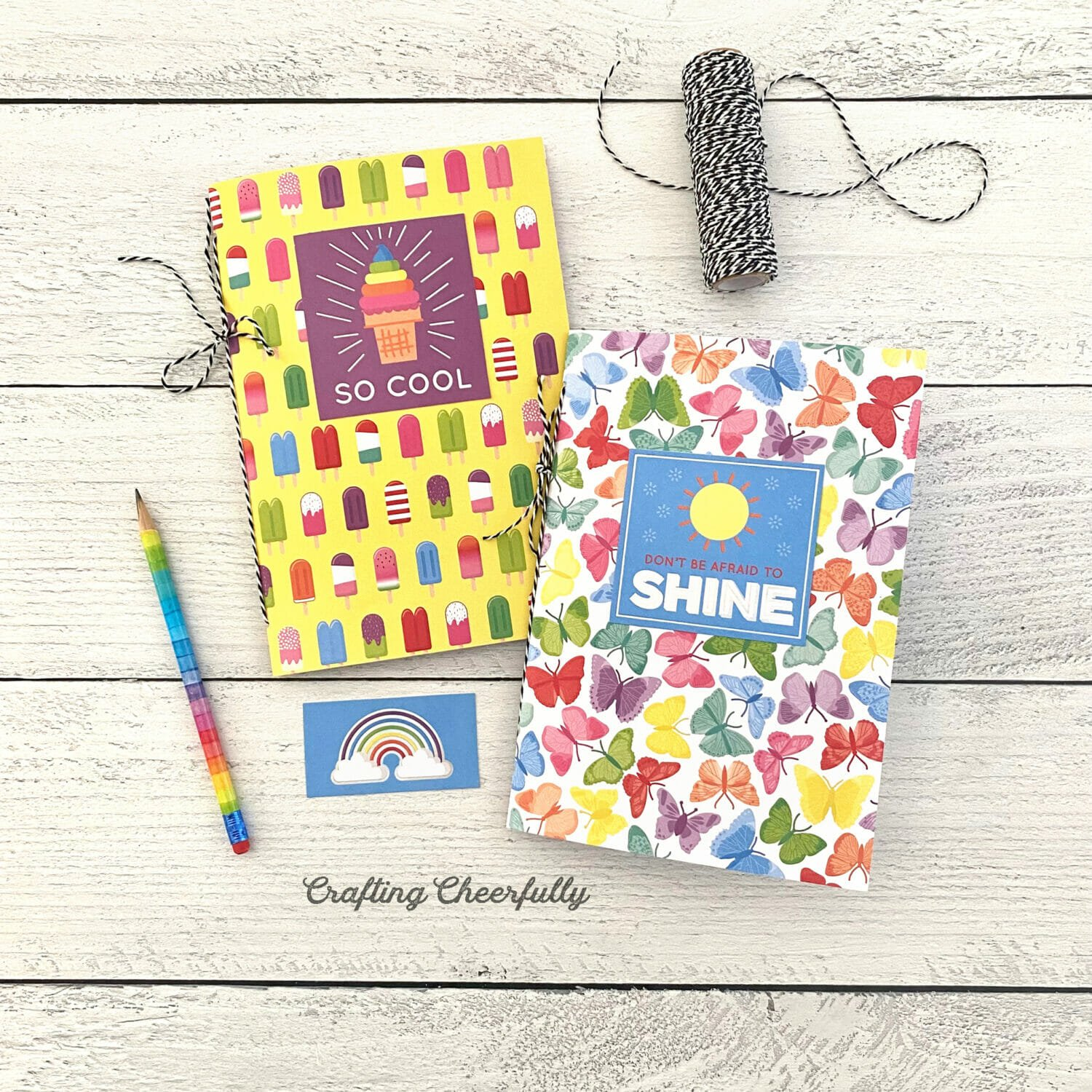 Colorful and fun summer journals laying on a table.