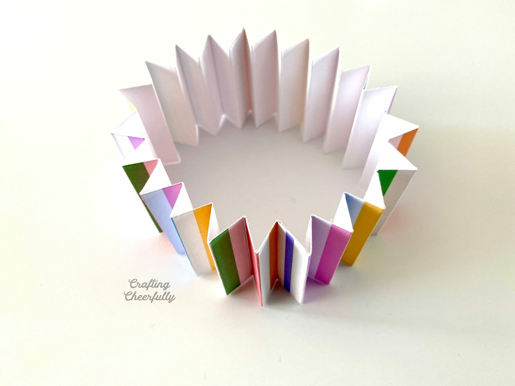 Piece of accordion-folded paper connected in a circle.