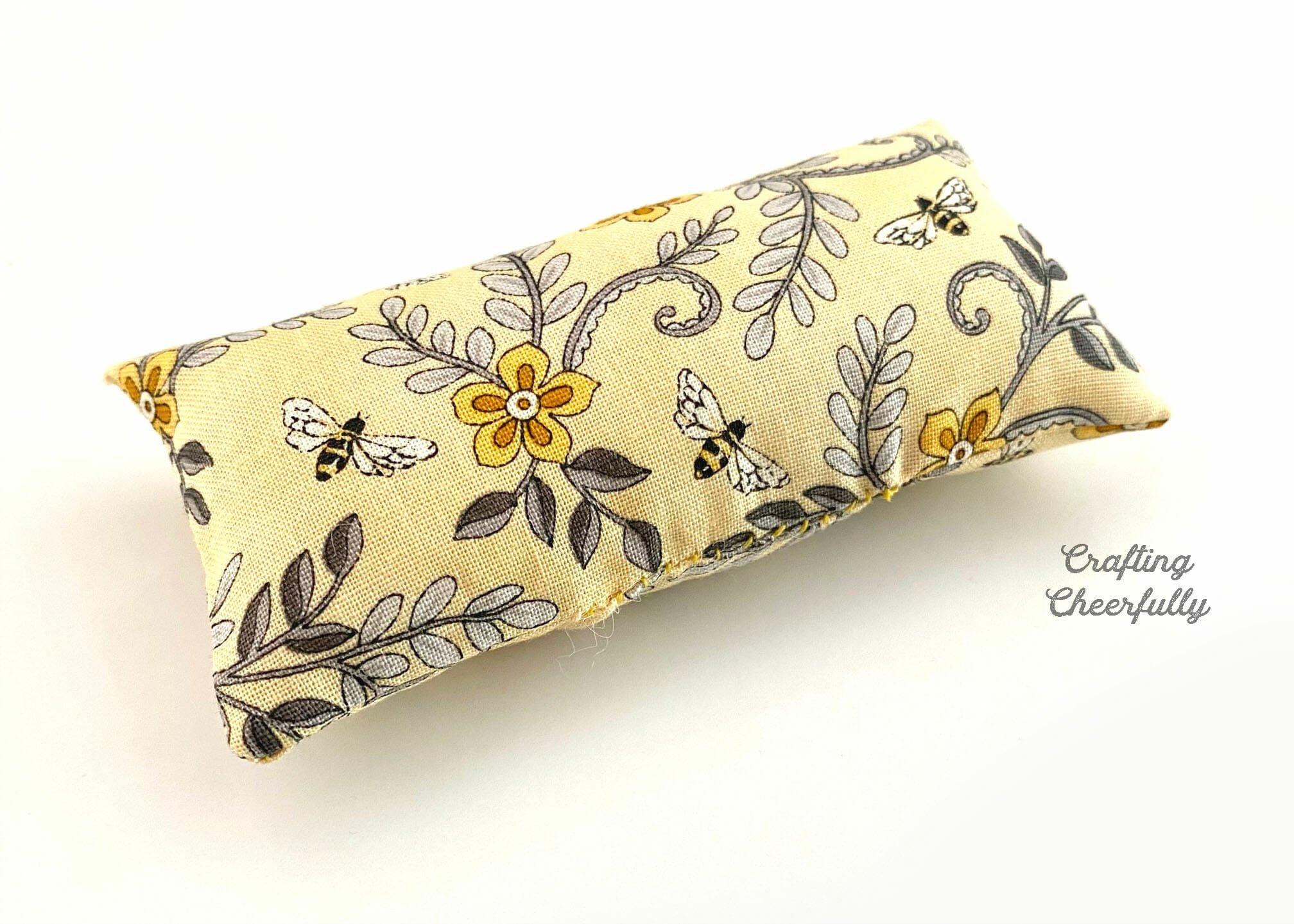 Floral mini fabric pillow.