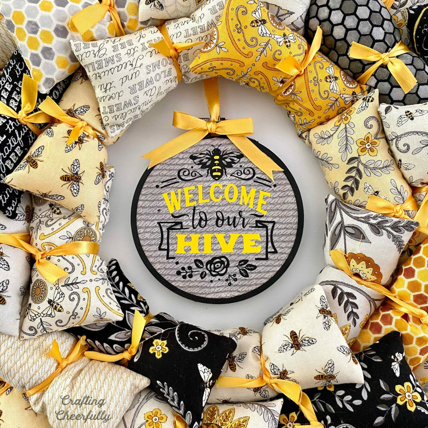 Bee Welcome Wreath with cute embroidery hoop in the middle.