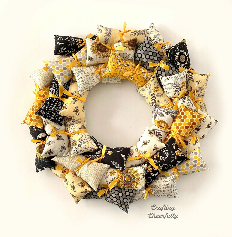 Black, yellow, gray and white pillow wreath.