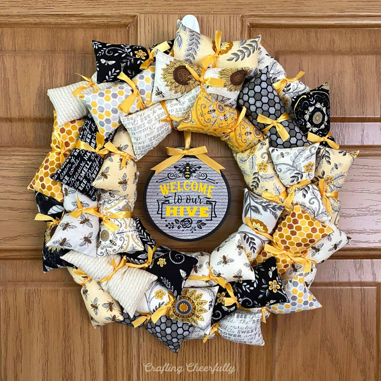 Welcome Bee Wreath on a wooden door.