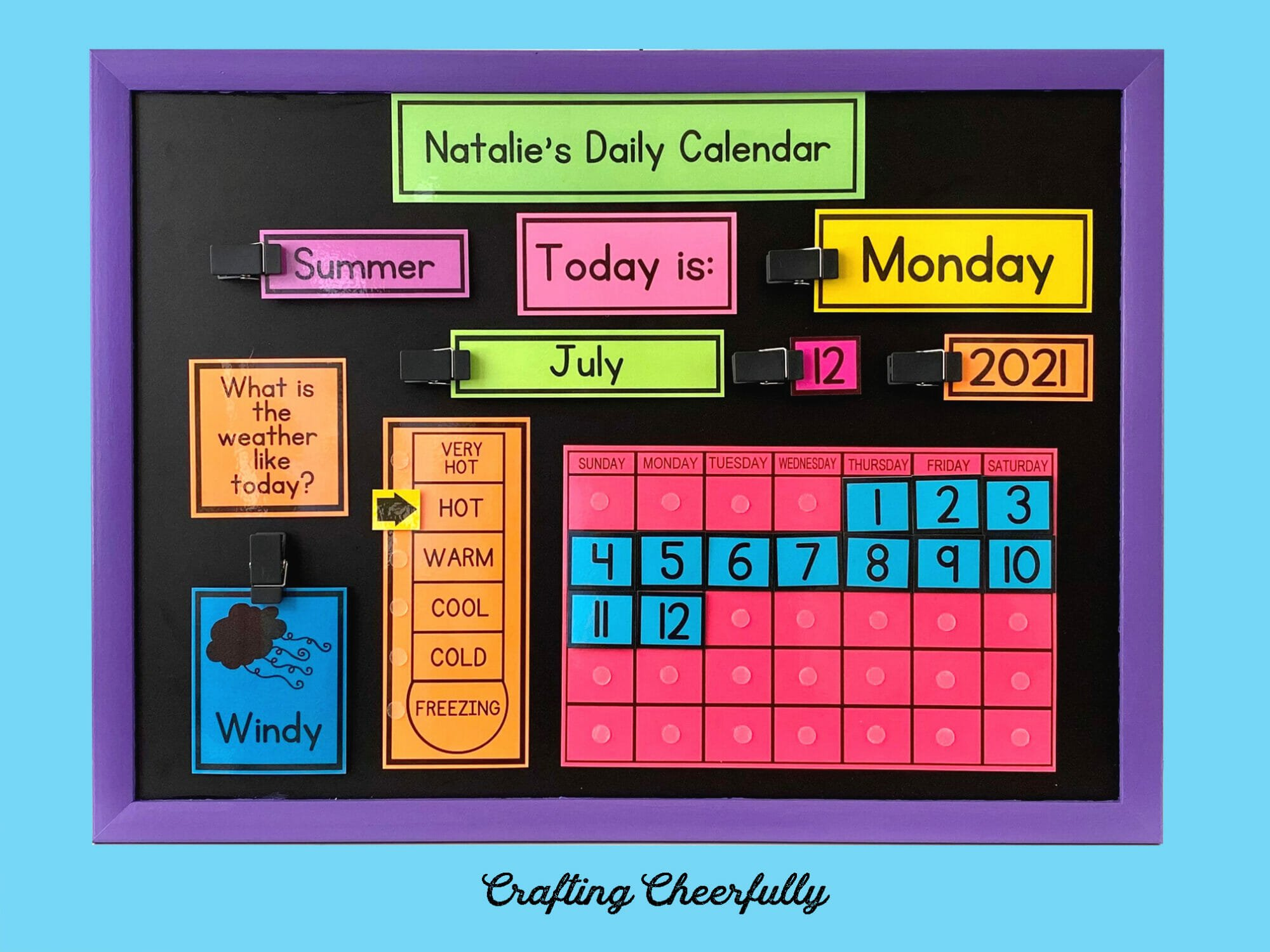 Chalkboard calendar with colorful bold printables on a blue background.