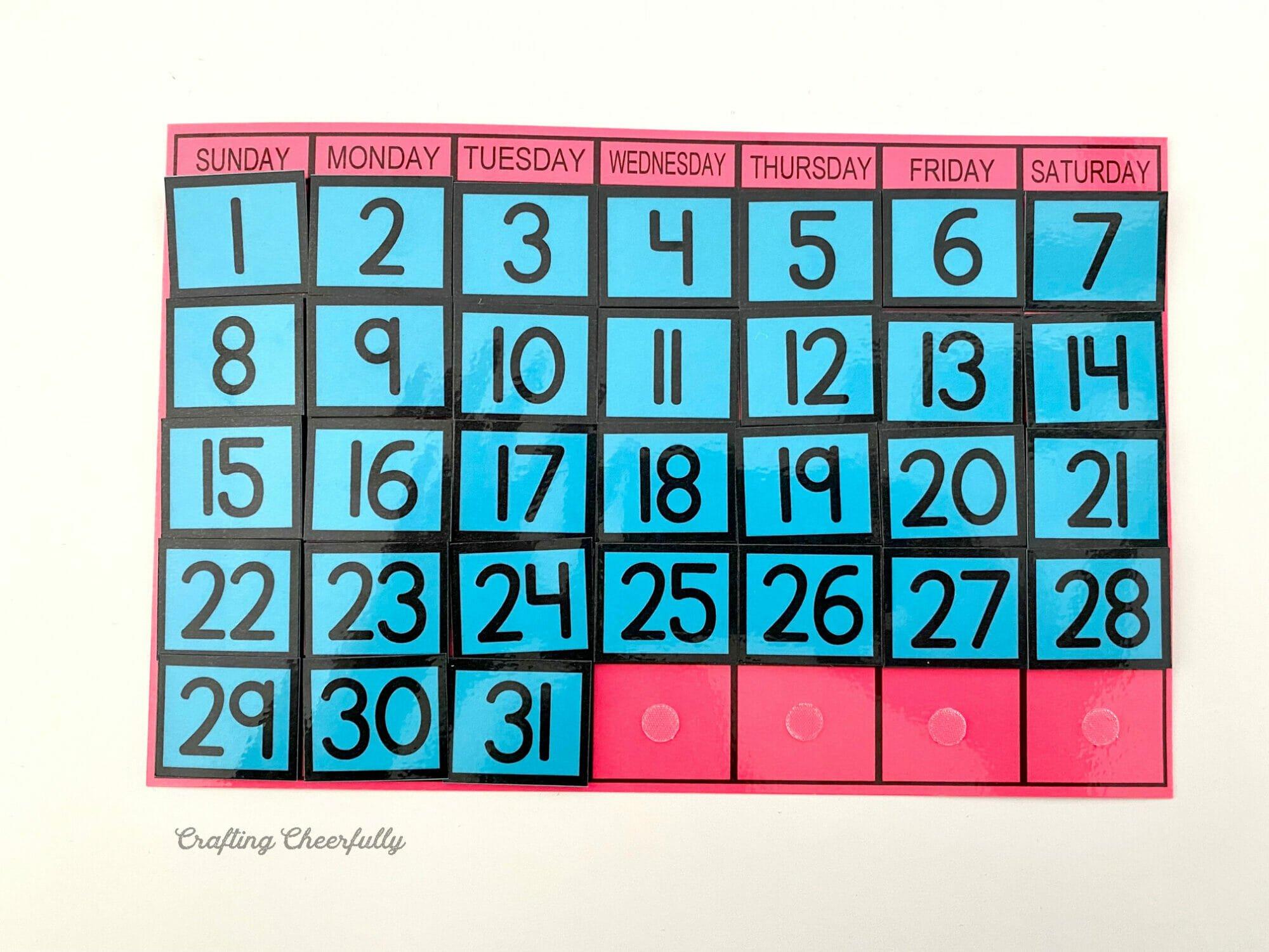 Pink calendar printable with blue calendar dates on it.