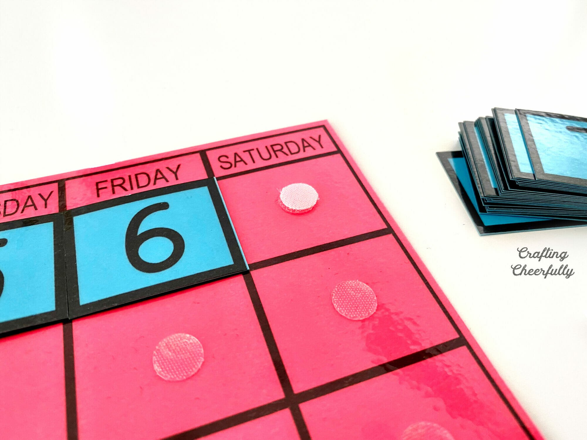 Velcro Thin Clear Fasteners are used to attach dates to a calendar printable.