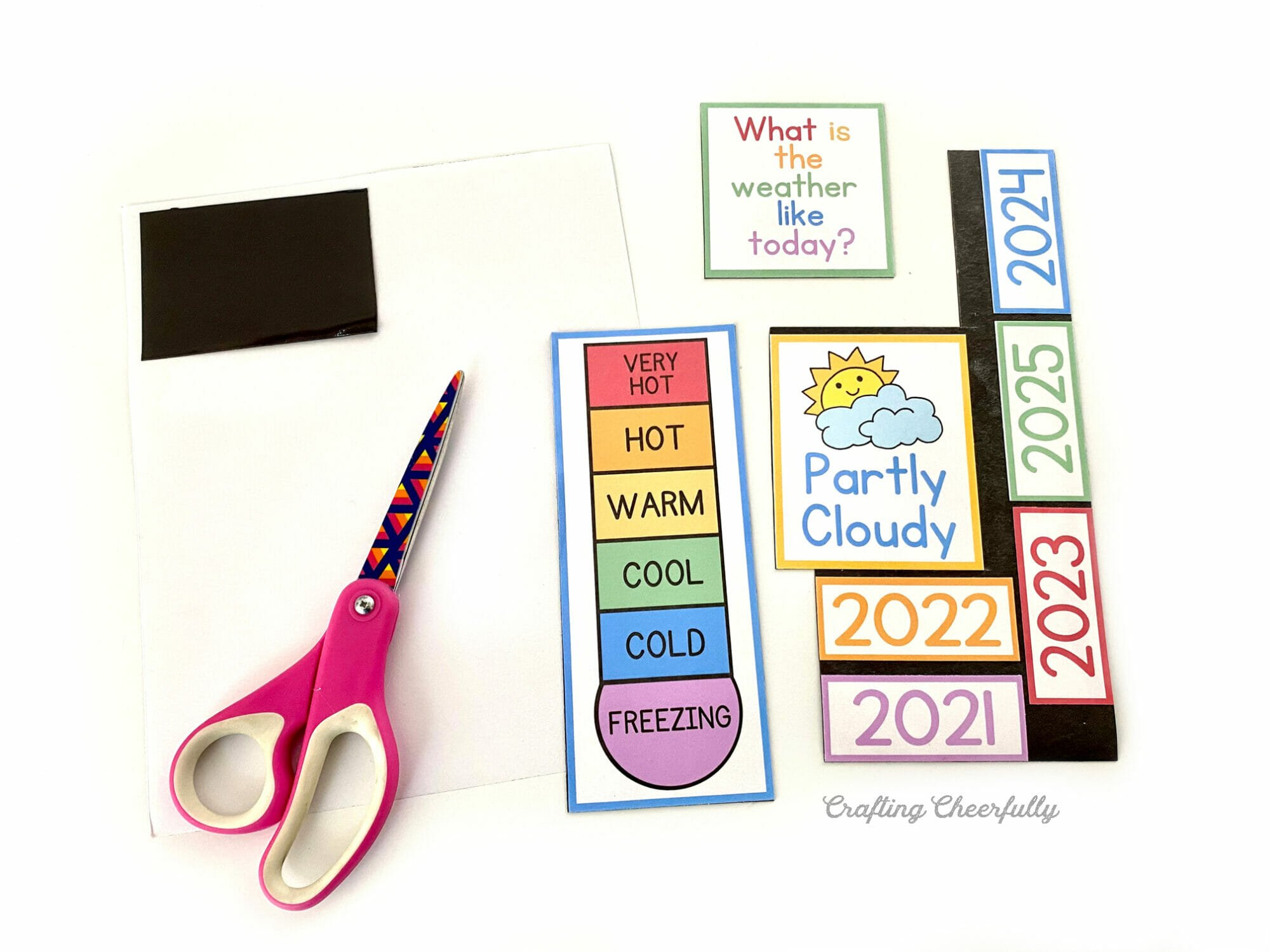 Calendar printables with a magnet sheets and scissors.