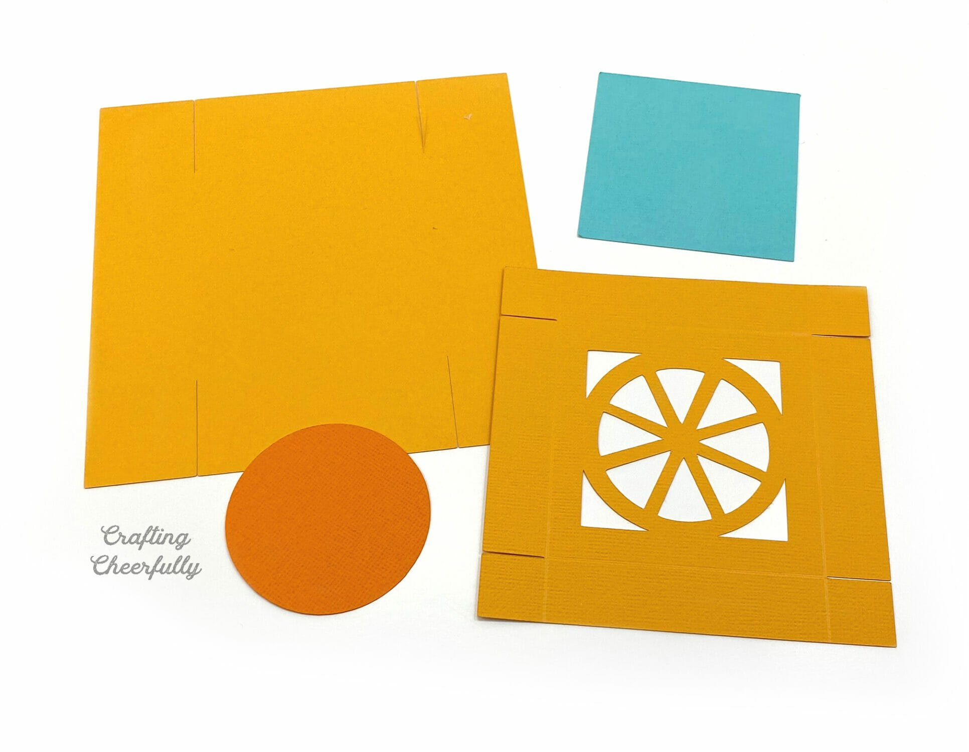 Cut pieces of paper to make an orange fruit box