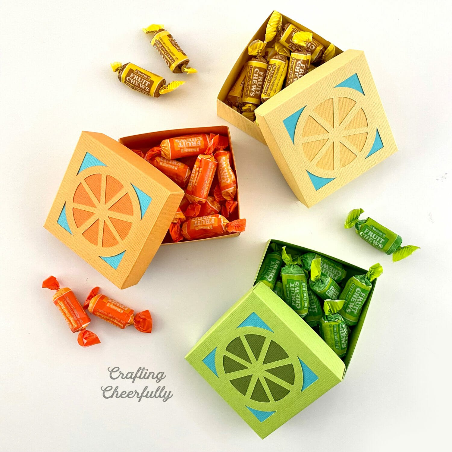 Orange, Lemon and Lime fruit boxes filled with candy.